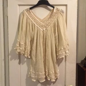 Delicate angle winged coverup or shirt